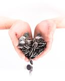 Hand with a handful of coins isolated on white background Stock Image