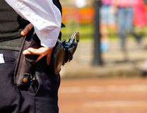 Hand and handgun Stock Photography