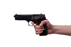 The hand with handgun isolated on white Royalty Free Stock Photo