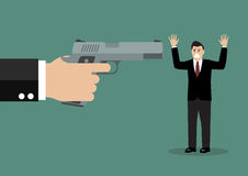 Hand with a handgun robs a businessman Royalty Free Stock Photo