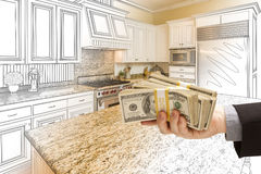 Hand Handing Cash Over Kitchen Design Drawing and Photo Combinat Stock Photos