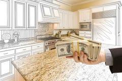 Hand Handing Cash Over Kitchen Design Drawing and Photo Combinat. Hand Handing Stacks of Money Over Custom Kitchen Design Drawing and Photo Combination Stock Photos
