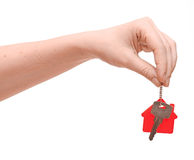 Hand is handing a house key Stock Images