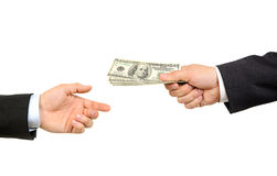 Hand handing over money to another hand stock photography