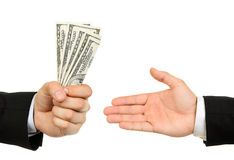 Hand handing over money to another hand Royalty Free Stock Images