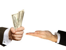 Hand handing over money to another hand isolated o Royalty Free Stock Images