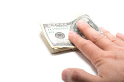 Hand handing a series of banknotes royalty free stock photo