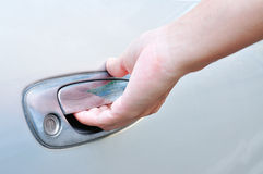 Hand on handle. Close-up of man in formalwear opening a car door Royalty Free Stock Photography