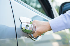 Hand on handle. Close-up of man hand opening a car door Royalty Free Stock Image