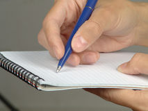 Hand with the handle,  daily log,  document. Stock Photos