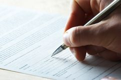 Hand with the handle,  daily log,  document Royalty Free Stock Image