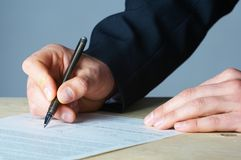 Hand with the handle,  daily log,  document Stock Photos