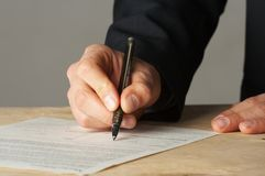 Hand with the handle,  daily log,  document Royalty Free Stock Photo