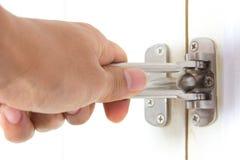 Hand on a handle wooden door Stock Image