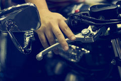 Hand on handlebars motorcycle. On dark background Royalty Free Stock Images