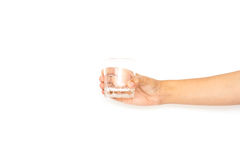 Hand. S holding a glass of water in isolated background Royalty Free Stock Images
