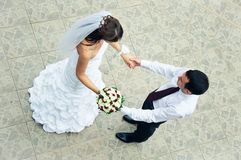 Hand in hands. top view of loving bride and groom Stock Image