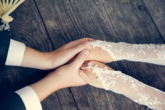 Hand in hands of wedding couple. loving care Royalty Free Stock Photography