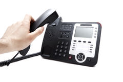 Hand with the handset and the phone Stock Images