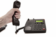 Hand with the handset and phone Royalty Free Stock Photo