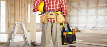 Hand of handyman with a tool bag. Hand of foreman with construction tool bag royalty free stock image