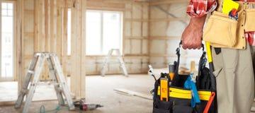 Hand of handyman with a tool bag. Hand of foreman with construction tool bag stock photography