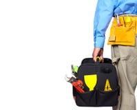Hand of handyman with a tool bag. Hand of foreman with construction tool bag stock photos