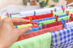 Hand hang on the clothespin clothing. Royalty Free Stock Image