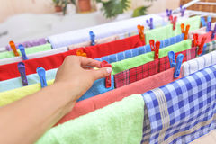 Hand hang on the clothespin clothing. Royalty Free Stock Images