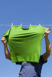 Hand hanging shirt. Royalty Free Stock Images