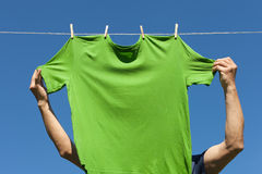 Hand hanging shirt. Stock Photography