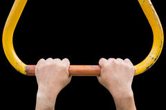 Hand hanging on steel bar for trapeze. Outdoor exercise equipmen Royalty Free Stock Photo