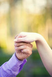 Hand happy in love. Man holding the hand of the beloved Royalty Free Stock Image