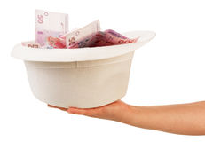 Hand with hat full of money Royalty Free Stock Photo