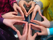 Hand and the heart. Some girls use their hands to make a heart figure Royalty Free Stock Images