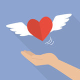 Hand with heart flying Royalty Free Stock Photography