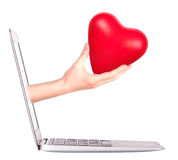Hand with a heart - gift and laptop Stock Images