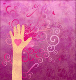 Hand with heart giving love Stock Photo
