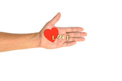 Hand with heart and letter LOVE Stock Photo