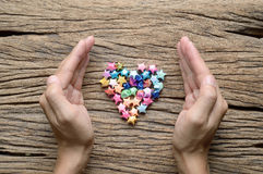 Hand with heart, love background Royalty Free Stock Image