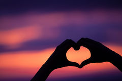 Hand heart shape love sunset Royalty Free Stock Photos