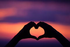 Hand heart shape love sunset Stock Images
