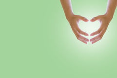 Hand on heart shape on white background with pastel sweet. Concepts Environment Day royalty free stock image