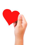 Hand and heart shaped paper Royalty Free Stock Images