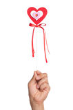 Hand with heart on a stick Royalty Free Stock Photography