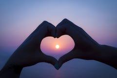 Hand Heart sunset on Rhodes, Greece Royalty Free Stock Photos