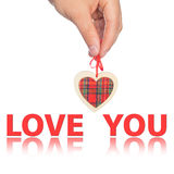Hand with  heart and  word love you. On the background Royalty Free Stock Images