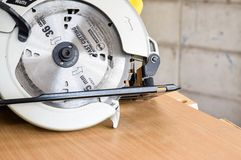 Hand-held circular saw. Use for cutting many materials such as wood, plastic, metal etc.  alway use in woodworking `cause it`s easy to use and carry Royalty Free Stock Photo
