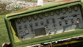 Green tank dashboard. A hand held, close up shot of a green tank dashboard, left to rust and go to waste in the open air stock footage