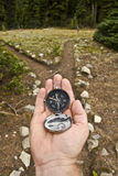 Hand Held compass at Trail Junction Royalty Free Stock Image
